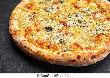 4 cheese pizza on a dark background