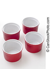 ramekin - 4 empty ceramic  ramekins on white background