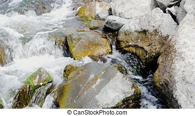 4 in 1. Set of footages with cascade of the mountain river. Water flowing through rock in river during hike of the valley of desolation