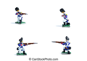 4 in 1 shot of handmade metal soldiers with musket on the white background