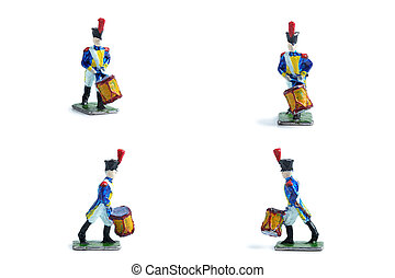 4 in 1 shot of handmade tin soldiers with drum on the white background
