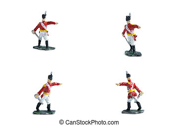 4 in 1 shot of handmade tin soldiers with sword on the white background