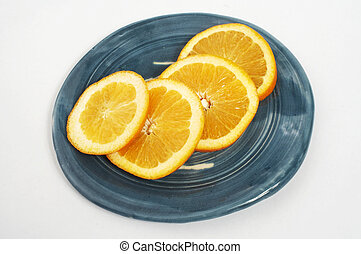 4 orange ( Citrus sinensis ) slices on a white background
