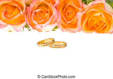 4 Red yellow roses and wedding ring over white