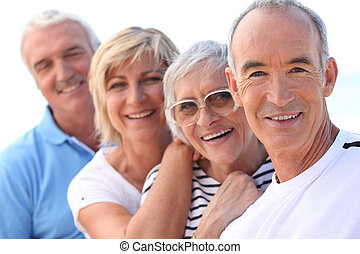 4 senior people laughing
