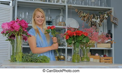 4 shots. Professional florist making beautiful bouquet at flower store