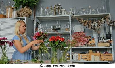 4 shots. Professional florist making floral wedding composition at flower shop