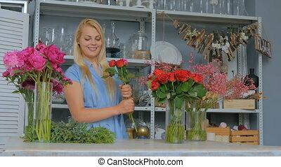 4 shots. Professional florist making beautiful bouquet at...