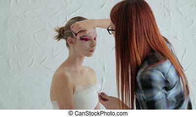 4 shots. Professional make-up creating face makeup art - 4...