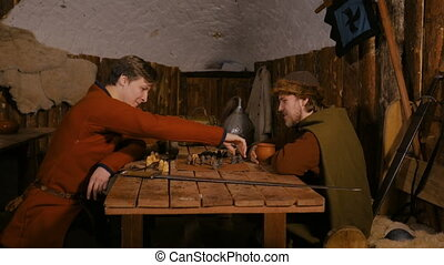 4 shots. Two men playing popular strategy board game - tafl...