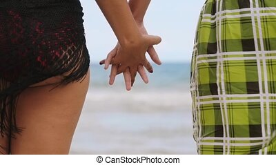 4-Slowmotion Teenager Couple Holding Hands On Beach