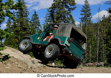 Vintage vehicle tackling a 4-wheel drive only trail in the Rocky Mountains of Colorado.