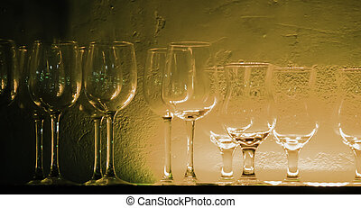 4 Wine glasses and glasses on a shelf in a bar
