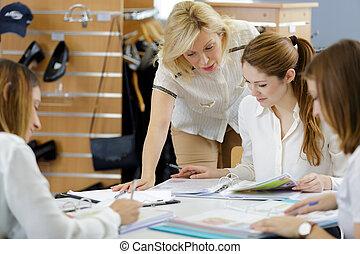 4 women in a classroom