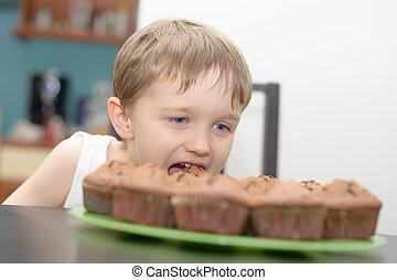 4 year old boy eats chocolate cake