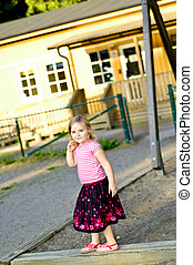 4 years old girl on playground