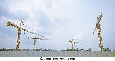 4 yellow crane at underconstruction zone