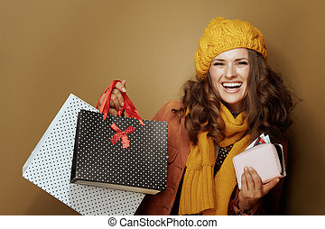 40 year old woman with credit card, purse and shopping bags
