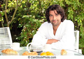 40 years old man having breakfast
