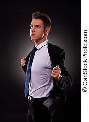 a young businessman taking off his jacket