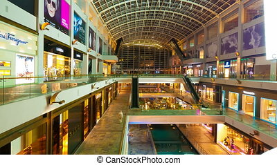 SINGAPORE - MAY 7, 2012: 4k (4096x2304) Timelapse in motion. Many people in the mall The Shopps at Marina Bay Sands.