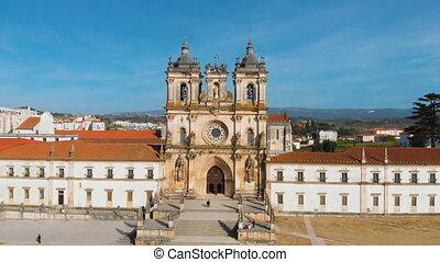 4k aerial drone footage of Mosteiro de Santa Maria de Alcobaca or Roman Gothic Monastery of Alcobaca, Unesco Heritage in Portugal. The church and monastery were the first Gothic building in Portugal.