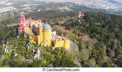 4k Aerial drone view of Pena Palace located in Sintra near Lisbon, Portugal. UNESCO World Heritage Site and popular tourist attraction in Lisboa Portugal