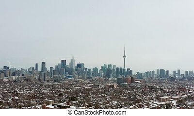4K Aerial Establishing shot of a Toronto neighborhood during...