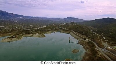 4K Aerial, Flight along a barrier lake in Andalusia, Spain -...