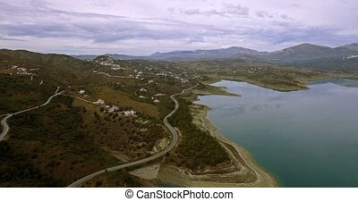 4K Aerial, Flight along a barrier lake in Andalusia, Spain