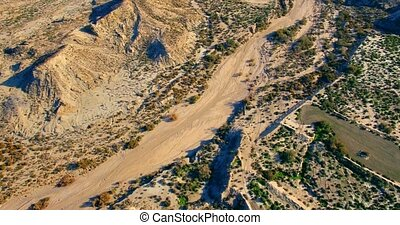 4K Aerial, Flight over a riverbed - Shot is additionally...