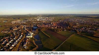 4K Aerial, Flight over landscape around small village in germany