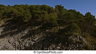 4K Aerial, Flying in the mountains with view on La Capellania, Andalusia, Spain