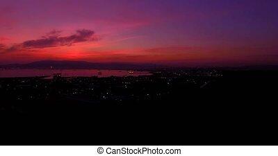 4K Aerial, Sunset and night flight near Gibraltar, Spain