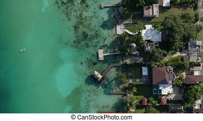 4k Aerial Vertical View while Moving Forward Over the Docks in Bacalar
