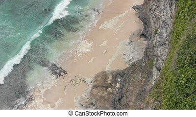 4K Aerial view of dreamland beach, Bali island.
