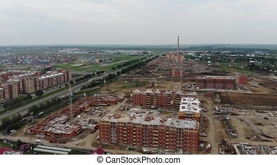 4k Aerial view of the city. Construction of residential...