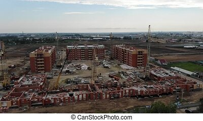 4k Aerial view of the construction site. Construction of...