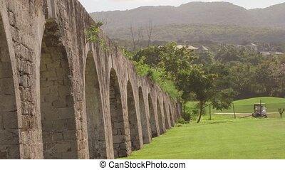 4k Ancient aqueduct Jamaica - Historic arches seaside ruins...