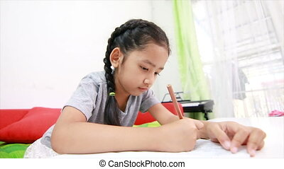 4K Asian little girl doing home work on the table for education concept
