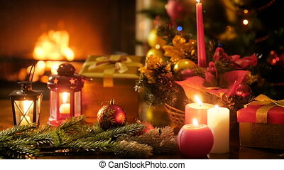 4k background with burning firepalce, Christmas tree and candles at New Years eve