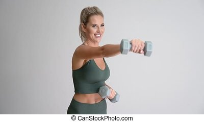 4K Beautiful woman working out with dumbells