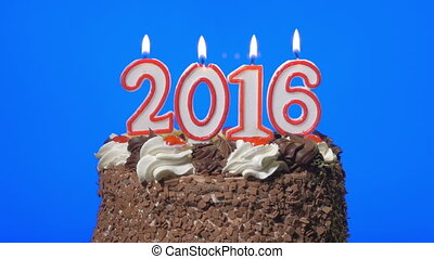 Blowing out new year 2016 candles