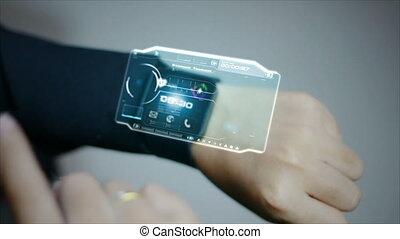 4K Business woman using smart watch with user interface HUD and graph bar pi for Cyber futuristic technology concept