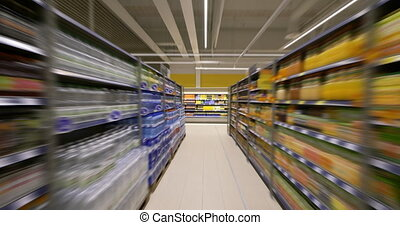 4K - Camera moves in the supermarket. Food shelves