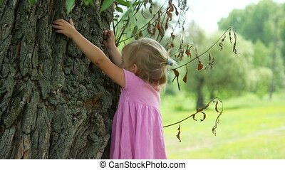 4K Child Playing Climbing Tree Outdoor in Park, Little Girl Portrait.
