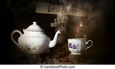 4K Cinemagraph - Cup of Tea and Teapot On Wooden Table With...
