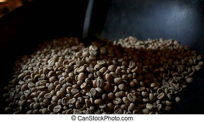 4K Close up shot roasting coffee bean by old method and...