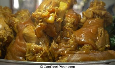 4k, close-up the cook prepares stewed pork leg, steam pork...