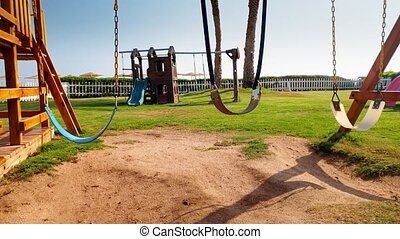 4k closeup footage of empty swing on the children playground...